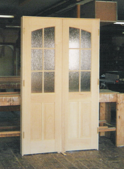 Arch top doors custom madebuilt wood interior exterior entryway double inner arch interior door unit pattern obscured glass on top and wood panels at the bottom renovation project in long island ny planetlyrics Gallery